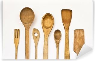 different kitchen wooden utensils on a white background Vinyl Wall Mural