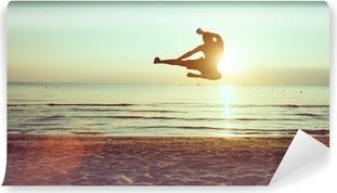 flying kick on the beach Vinyl Wall Mural