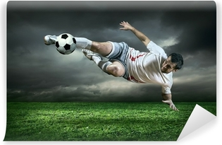 Football player with ball in action under rain outdoors Vinyl Wall Mural