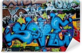 Graffiti detail on the textured brick wall Vinyl Wall Mural