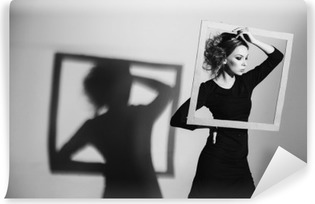 Сharismatic woman frame in his hands, fashion pose, black and white photo, studio shooting negativity, loneliness, divorce, pain, depression Vinyl Wall Mural