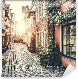 Historic street in Europe at sunset Vinyl Wall Mural