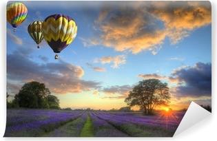 Hot air balloons flying over lavender landscape sunset Vinyl Wall Mural