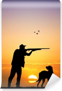 hunter with dog at sunset Vinyl Wall Mural