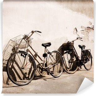 Italian old-style bicycles leaning against a wall Vinyl Wall Mural