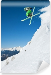 Jumping skier in mountains Vinyl Wall Mural