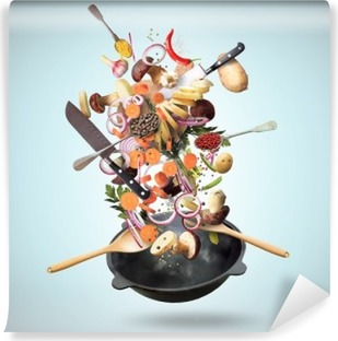 Large iron skillet with falling vegetables and mushrooms Vinyl Wall Mural