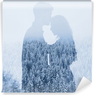love in winter, silhouette of couple on forest background, double exposure Vinyl Wall Mural