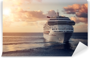 Luxury cruise ship leaving port at sunset Vinyl Wall Mural