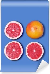 Minimal Design. Fresh Grapefruit on a blue background Vinyl Wall Mural