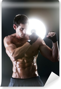 Muscular sports guy with a naked torso boxing Vinyl Wall Mural