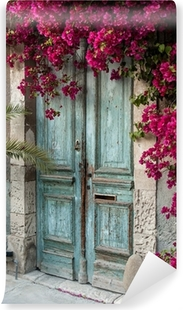 Old wooden door with bougainvillea in Cyprus Vinyl Wall Mural