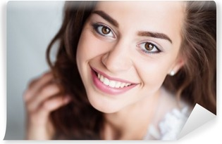 Portrait of smiling woman with perfect smile and white teeth looking at camera Vinyl Wall Mural