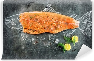 raw salmon fish steak with ingredients like lemon, pepper, sea salt and dill on black board, sketched image with chalk of salmon fish with steak Vinyl Wall Mural