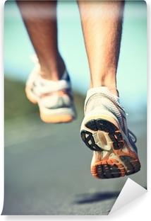 Runnning shoes on runner Vinyl Wall Mural