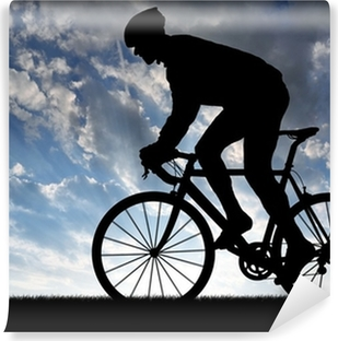 silhouette of the cyclist riding a road bike at sunset Vinyl Wall Mural