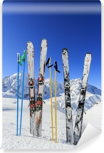 Skiing, mountains and ski equipments on ski run Vinyl Wall Mural