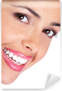 Smiling young woman face. Over white background. Vinyl Wall Mural