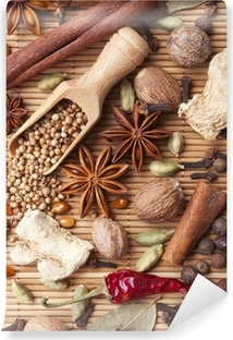 Spices and herbs over bamboo mat Vinyl Wall Mural