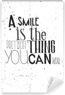 The phrase, a smile is the prettilest thing you can wear Vinyl Wall Mural