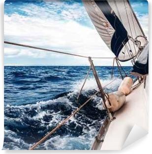 The white sails of yachts on the background of sea and sky in the clouds Vinyl Wall Mural