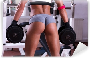 Very sexy young beautiful ass in thong at gym club Vinyl Wall Mural