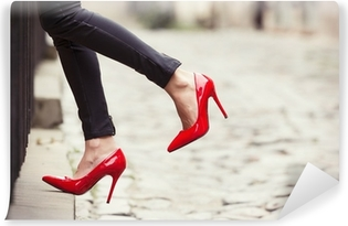 Woman wearing black leather pants and red high heel shoes Vinyl Wall Mural