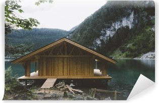 Wood house on lake with mountains and trees Vinyl Wall Mural
