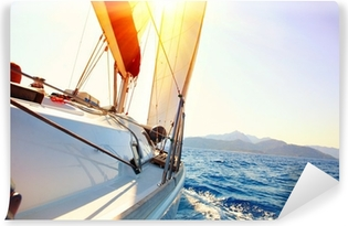 Yacht Sailing against sunset. Sailboat. Yachting. Sailing Vinyl Wall Mural