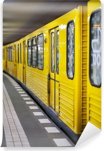 Yellow metro in subway station. Berlin, Germany. Vinyl Wall Mural