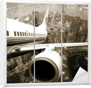 Airplane take off from the city Wardrobe Sticker