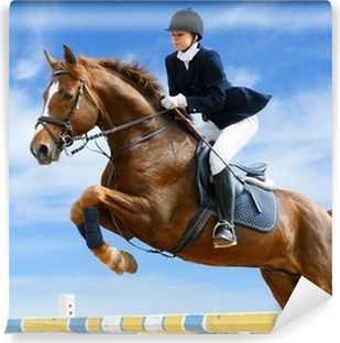 Equestrian jumper - Young girl jumping with sorrel horse Washable Wall Mural