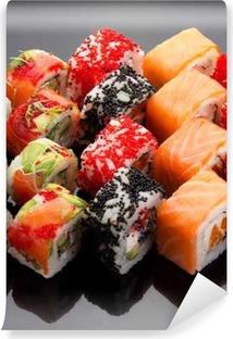 Japanese cuisine. Sushi set over black background. Washable Wall Mural