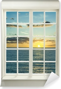 Modern residential window with sunset over sea and clouds Washable Wall Mural