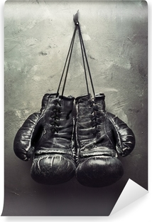 old boxing gloves hang on nail Washable Wall Mural