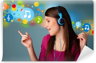 Young woman listening to music with headphones Washable Wall Mural