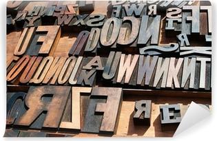 Zelfklevend Fotobehang Een bos van oude vintage houten blok drukpers letters.
