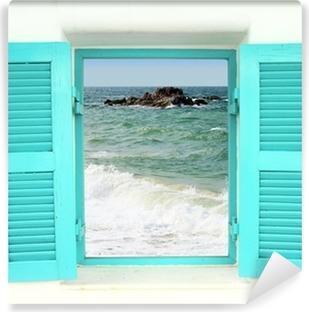 Zelfklevend Fotobehang Griekse stijl venster met uitzicht op zee