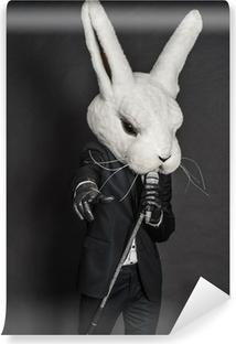 Zelfklevend Fotobehang Man in konijnmasker. zwart pak zingen op een donkere achtergrond