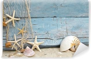 Zelfklevend Fotobehang Maritime vakantie geheugen: schelpen, zeesterren en visnet