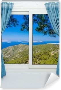 Zelfklevend Fotobehang Natuur landschap met een uitzicht door een raam met gordijnen