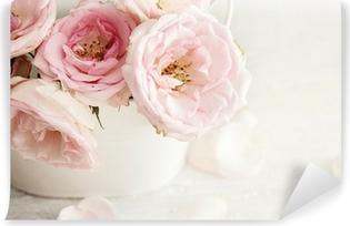Zelfklevend Fotobehang Roze bloemen in een vaas
