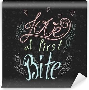 Zelfklevend Fotobehang Vector citaat hand getekende typografische op schoolbord achtergrond. Opschrift: Liefde op het eerste hap. Bacery collectie. Poster met greeting.Typographical ontwerp met creatieve slogan