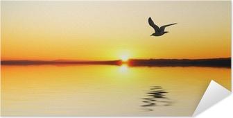 Zelfklevende Poster De gevel bij zonsopgang