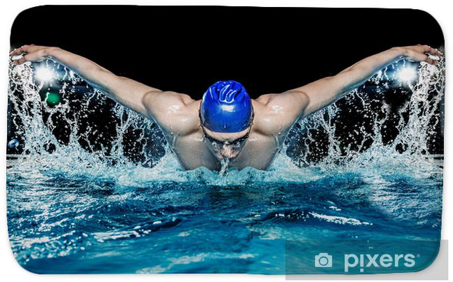Muscular young man in blue cap in swimming pool Bath Mat