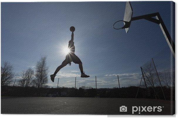 Canvas Basketbalspeler silhouet in de lucht op het punt om slam dunk - Basketbal