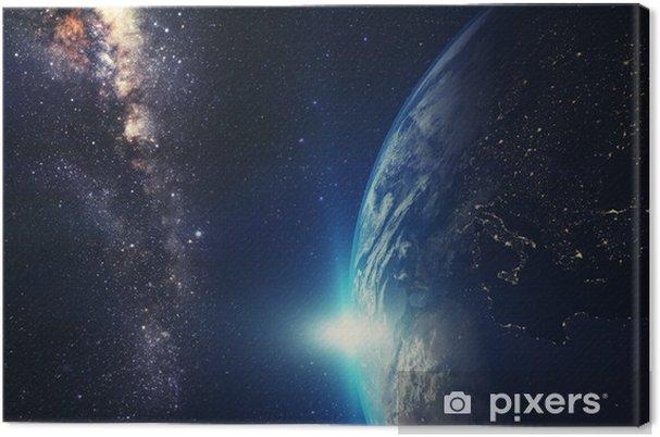 Canvas Blauw zonsopgang, mening van aarde vanuit de ruimte met Melkwegstelsel - Ruimte