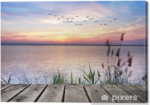Canvas Een houten steiger bij zonsondergang -