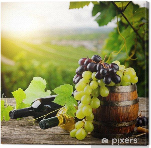 Canvas Flessen rode en witte wijn met verse druiven - Frankrijk
