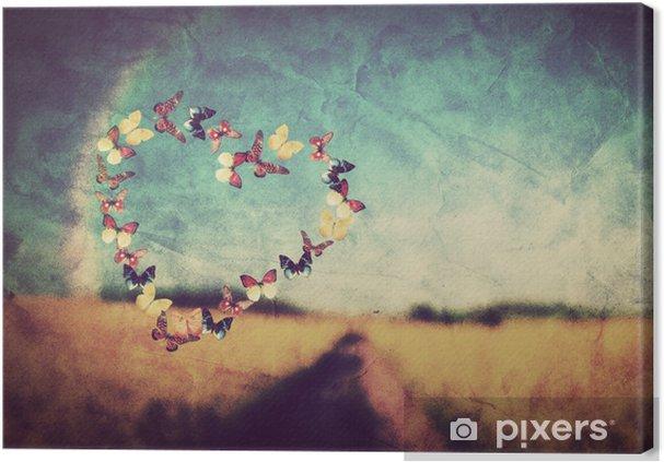 Canvas Hart vorm van vlinders op vintage achtergrond van een veld - Gelukkig